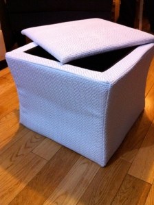 Before small white ottoman