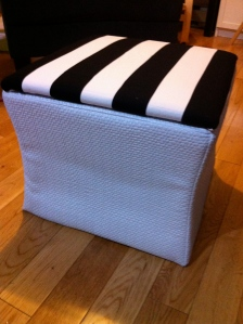 After small white ottoman with top covered with Sofia fabric