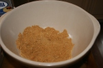 prepare for crust by crushing gingersnap cookies into bowl